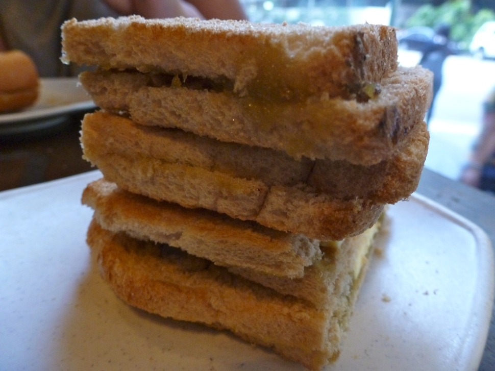 traditional singaporean breakfast - Kaya Toast. flat toasted bread with chunks of butter and kaya coconut jam