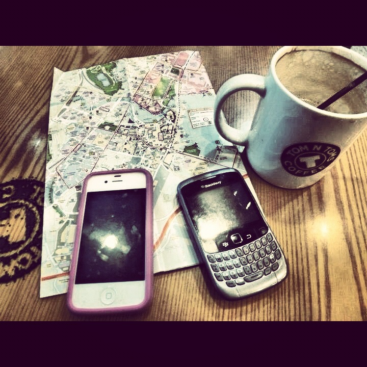 The ultimate travel essentials for the city slicker - coffee, map, iphone, bb