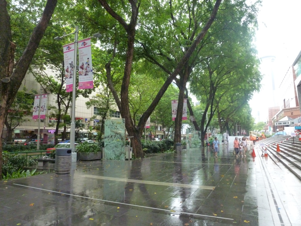 Walking down Orchard Road on a cold, rainy morning