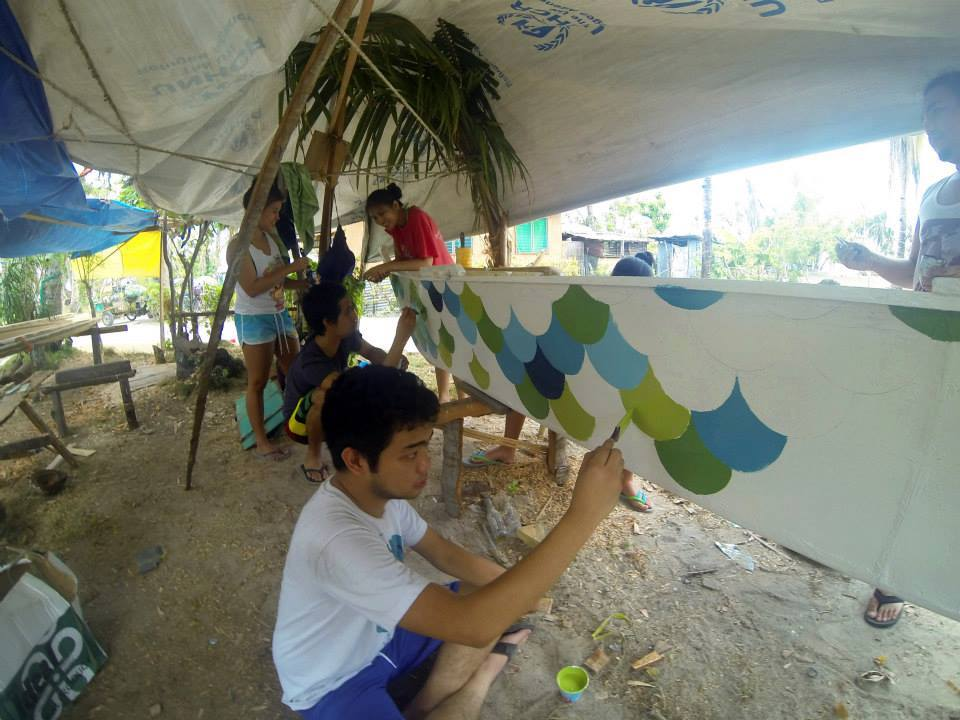 Volunteers painting boats for Yolanda Victims in Bantayan, Cebu (Philippines)
